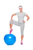 Active woman posing with blue ball Royalty Free Stock Photo