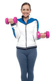 Active woman posing with dumbbells Royalty Free Stock Images