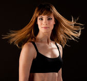 Active woman posing over balck background Stock Image