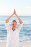 Active woman practicing yoga royalty free stock photos