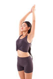 Active woman practicing yoga sun salutation, stretching exercise Stock Image