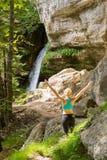Active woman raising arms inhaling fresh air, feeling relaxed in nature. Active woman raising arms inhaling fresh air, feeling relaxed and free in beautiful Stock Photo
