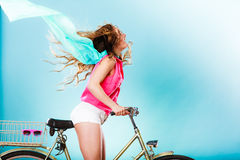 Active woman riding bike bicycle. Hair windblown. Stock Photography