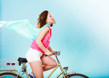 Active woman riding bike bicycle. Hair windblown. Royalty Free Stock Photo