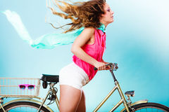 Active woman riding bike bicycle. Hair windblown. Royalty Free Stock Image