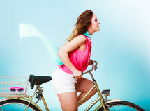 Active woman riding bike bicycle. Hair windblown. Stock Photos