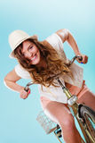 Active woman riding bike bicycle. Recreation. Royalty Free Stock Photo