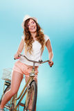 Active woman riding bike bicycle. Recreation. Stock Photography