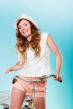 Active woman riding bike bicycle. Recreation. Royalty Free Stock Photos