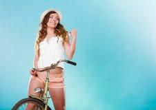 Active woman riding bike bicycle. Recreation. Stock Photos