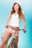 Active woman riding bike bicycle. Recreation. Royalty Free Stock Image