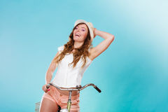 Active woman riding bike bicycle. Recreation. Stock Photo
