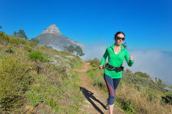 Active woman runner runs trail Stock Images