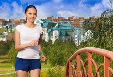 Active woman running in the park Stock Images