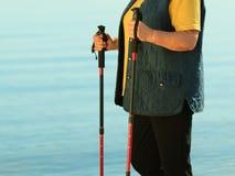 Active woman senior nordic walking on a beach Royalty Free Stock Photos