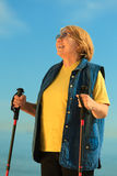 Active woman senior nordic walking on a beach Stock Images