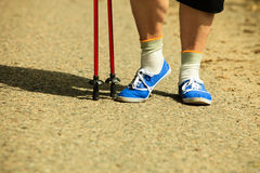 Active woman senior nordic walking in park. legs Royalty Free Stock Photography