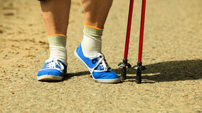 Active woman senior nordic walking in park. legs Royalty Free Stock Images