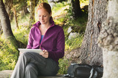 Active Woman with a Tablet in a Forest Royalty Free Stock Photo
