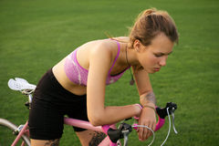 Active woman tired from riding a bicycle Stock Images