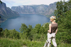 Active woman at the top of mountains over the lake Royalty Free Stock Photography