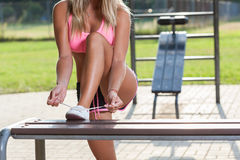 Active woman tying her shoes Royalty Free Stock Photography