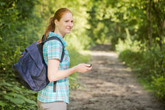 Active Woman on a Walk in a Forest Royalty Free Stock Images
