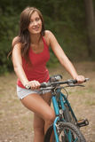 Active Woman With Bike Stock Photo