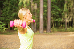 Active woman working out with dumbbells Stock Photo