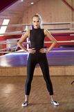 Active woman in catsuit. Active woman after workout in catsuit posing in studio gym stock photos