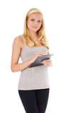 Active woman writing on clipboard Stock Image
