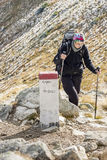 Active women on mountain path - Tatras Mountains. Stock Photo
