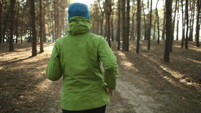 Active women's trail running in forest in the sunny day. stock video
