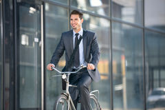 Active young businessman on bike Royalty Free Stock Photo
