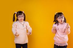 Active young children with mental disorder having same hairstyle. Being extremely lovely. Active young children with mental disorder having same hairstyle and royalty free stock photos