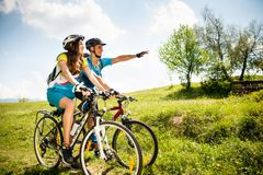 Free ACTIVE Young Couple Biking On A Forest Road In Mountain On A Spring Day Royalty Free Stock Image - 113759446