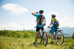 Free ACTIVE Young Couple Biking On A Forest Road In Mountain On A Spring Day Royalty Free Stock Image - 123570456