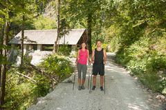 Active young couple on a hike in forest on a hot wummer day.  Royalty Free Stock Image