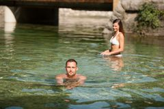 Active young couple plays in shallow water on a hot summer morning.  royalty free stock photo