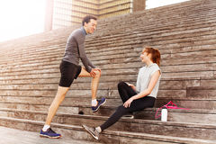 Active young couple resting after workout outdoors Royalty Free Stock Photos