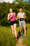 Active young couple running in the park Stock Images