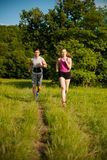 Active young couple running in the park.  Royalty Free Stock Image
