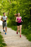 Active young couple running in the park.  Stock Photography