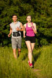 Active young couple running in the park.  Stock Photo