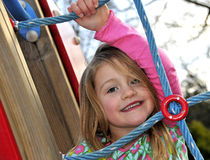 Active Young Girl. Playing on Outdoor Park Equipment Stock Photos