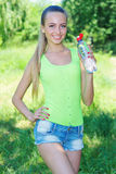 Active young girl with bottle of water Stock Photo