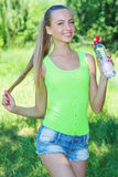 Active young girl with bottle of water Royalty Free Stock Image