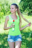 Active young girl with bottle of water Royalty Free Stock Photography