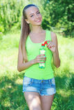 Active young girl with bottle of water Stock Photography