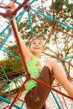 Active Young Girl Climbing Stock Photography